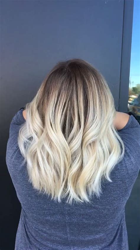 bleach blonde hair with low lights short style trendy hair highlights blonde balayage dark roots with