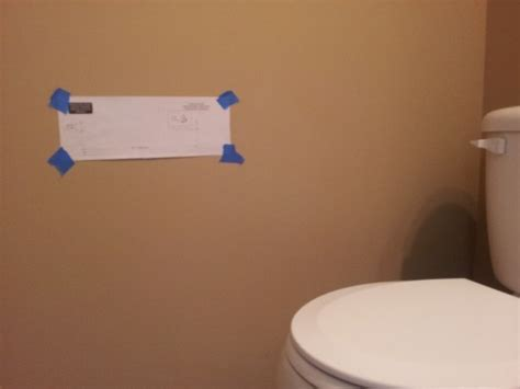 where to put toilet paper holder in small bathroom tape the mounting template to the wall using masking tape