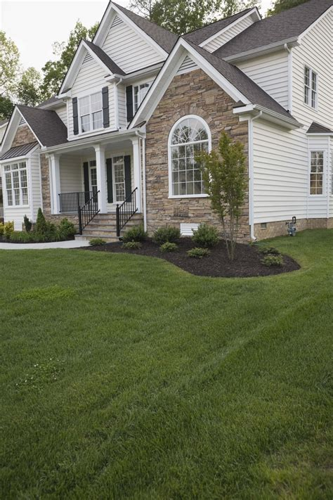 cost to redo backyard how to drain water from the side of a house home guides