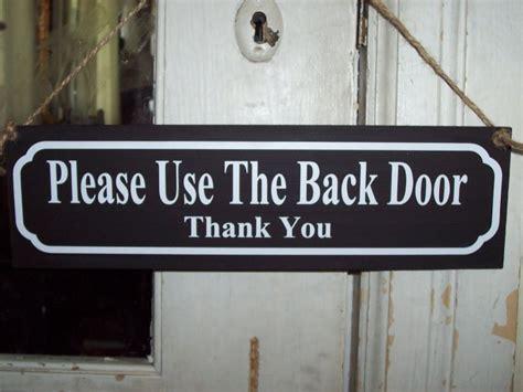 Back Door Signs by Use Back Door Wood Vinyl Sign Home Decor Wreath