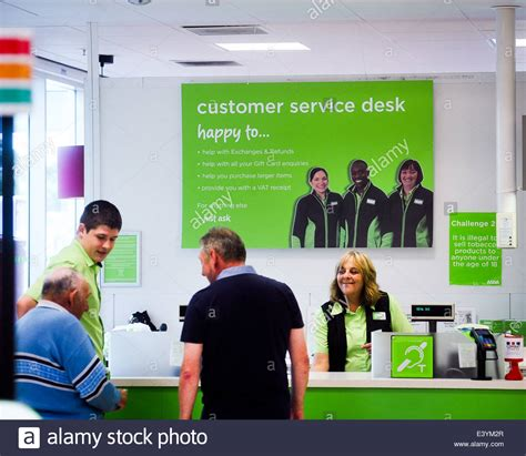being helped at a customer service desk in asda
