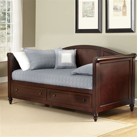 a day bed light brown wooden daybed with two storage on the bottom plus bars on the side boards