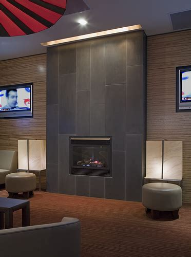 cast concrete tiled fireplace in coal tiled fireplace