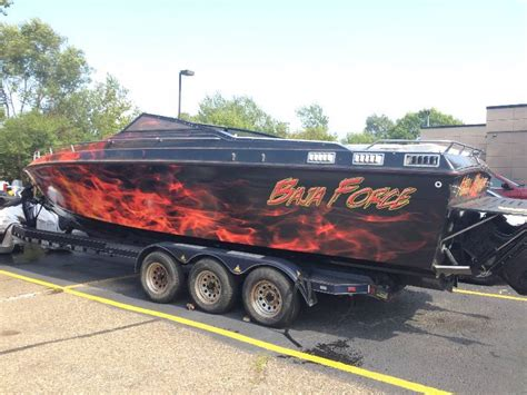 boat salvage in minnesota one of a kind baja boat drag motorcycle scooter auction