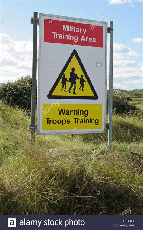 trainers in my area area warning signs on braunton burrows near saunton stock photo