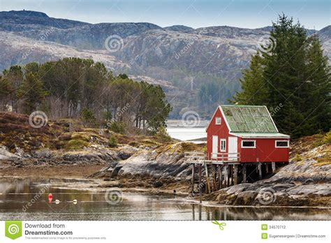 Good Small Country House Plans With Photos #8: Red-wooden-house-coast-norway-stands-sea-34570712.jpg