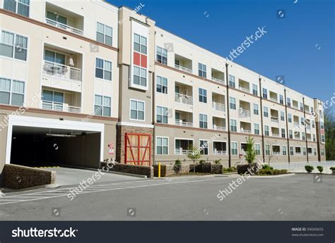building a garage apartment modern apartment building with parking garage stock photo