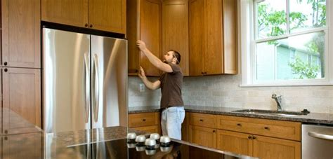 how to reface your kitchen cabinets what s smarter replacing or refacing your cabinets yahoo homes