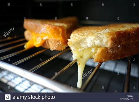 melting in oven melting cheese sandwich in a toaster oven stock photo