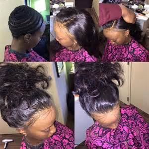 hair do with sew in weave with a part in the middle full head sew in no leave out not even baby hair no