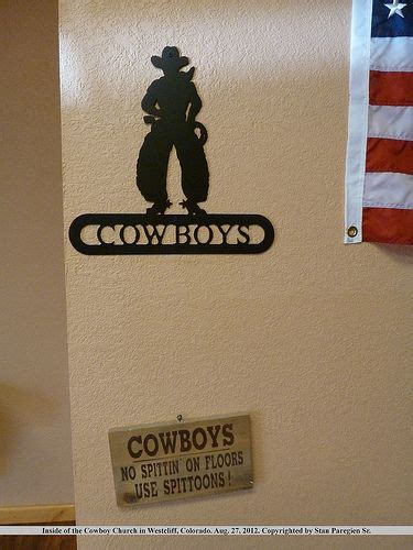 cowboy bathroom signs sign directing to the s restroom at the west