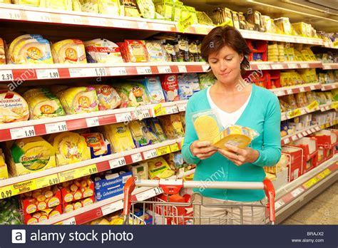 choosing cheese in the supermarket stock photo