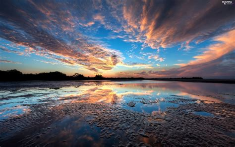 east lake reflection oregon sun clouds beautiful