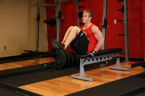 seated flat bench leg pull in exercise guide and video