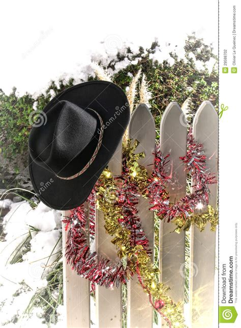 american west rodeo cowboy hat  christmas fence stock photography image