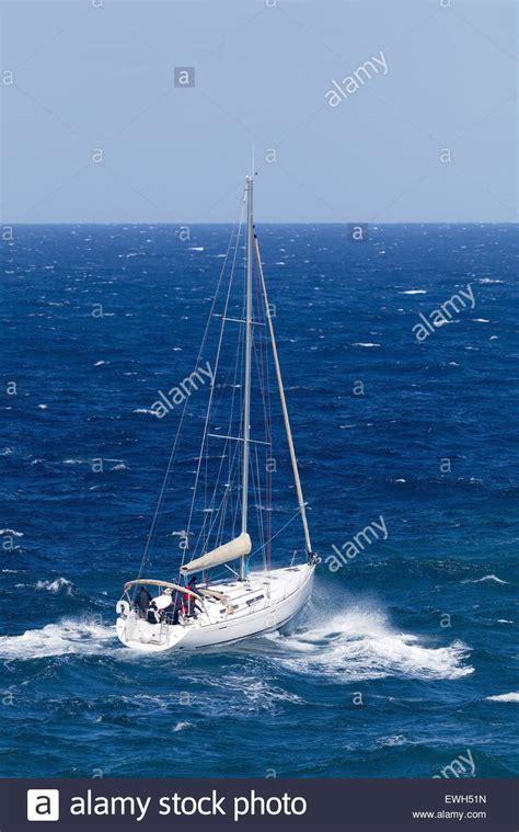 sailing boat under power sailing rough sea stock photos sailing rough sea stock