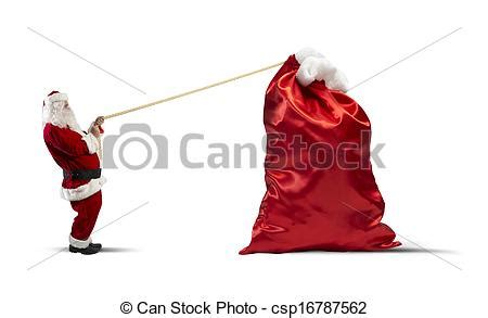 stock image of heavy bag of gifts santa claus pulls