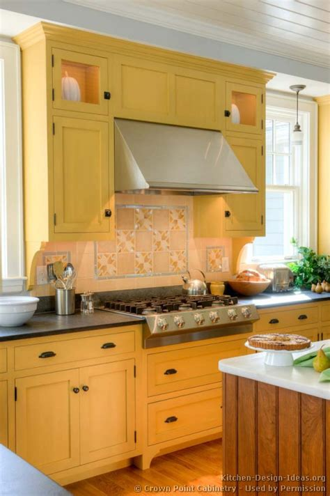 crown point kitchen cabinets traditional yellow kitchen with a custom wood island