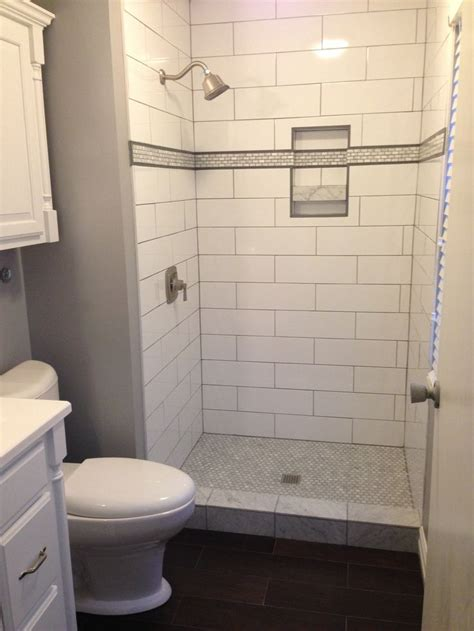 large white tile bathroom large subway tile with strip and niche shower tile