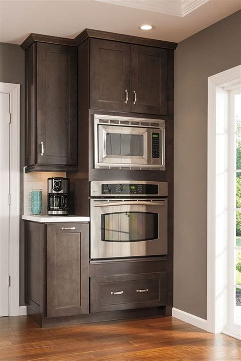 this tall microwave and oven cabinet follows the current