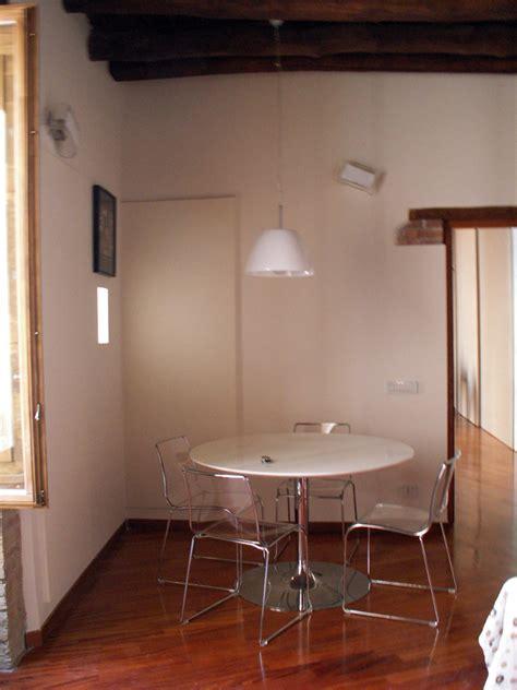 soggiorno con tavolo da pranzo progetto ristrutturazione di appartamento in edificio