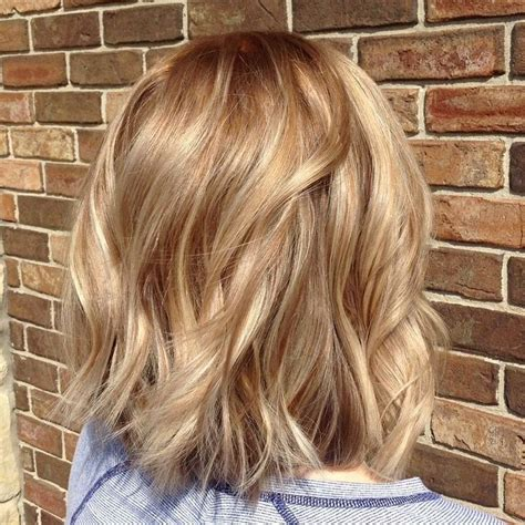 warm color hair highlight palette warm blond balayage on shattered bob hair cut blonds