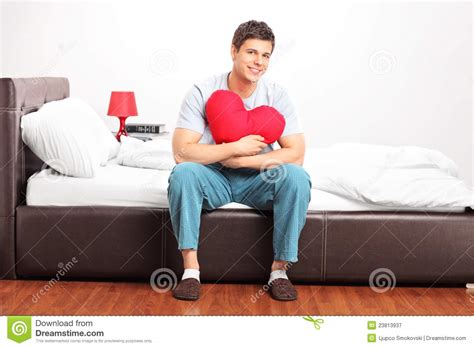 Sitting On by Sitting On A Bed Royalty Free Stock Photography