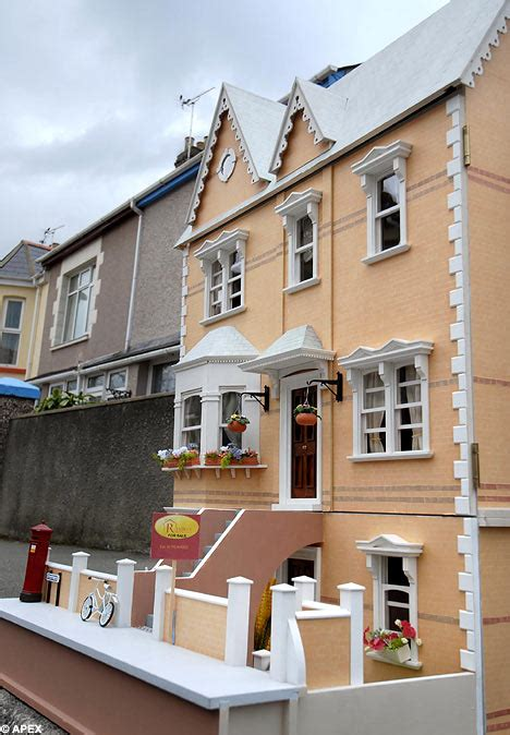 victorian dolls house for sale 163 1 500 victorian doll s house for sale in estate agent s window daily mail online