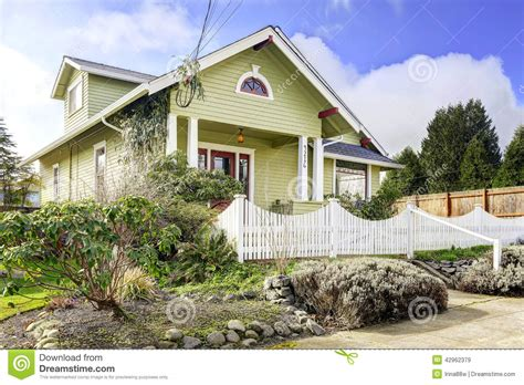 What Does A Green Light Outside A House by Light Green House Exterior With Column Porch And White Fence Stock Image Image 42962379