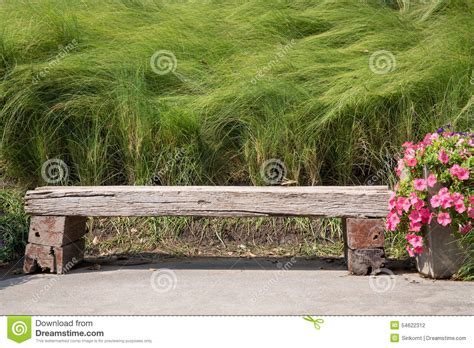 Rug Cushion by Long Wood Chair In A Garden Stock Photo Image 54622312