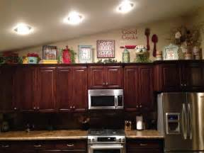 above kitchen cabinet decor home sweet home pinterest tips decorating above kitchen cabinets my kitchen