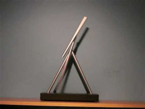 perpetual motion swinging sticks kinetic solar system desk toy avi doovi