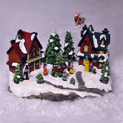 animated christmas village scene with flying santa sound