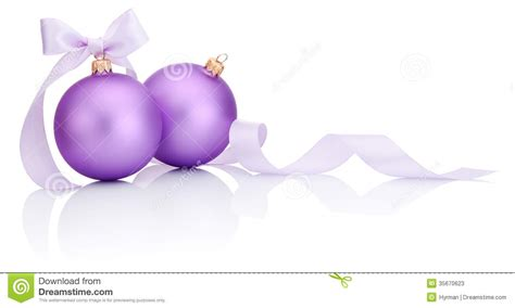 two purple christmas balls with ribbon bow isolated on