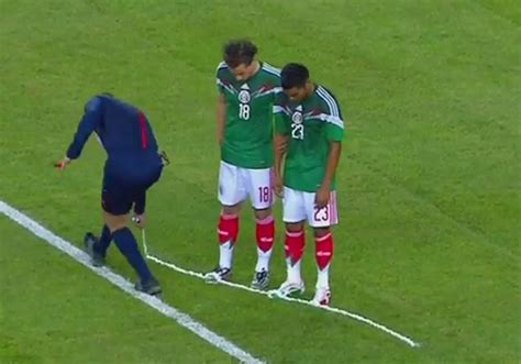 referee vanishing spray on boots player at world cup 2014