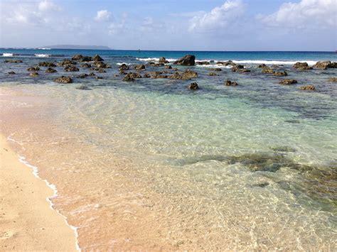 Batu Motif Ombak Laut Merah gambar pantai laut pasir batu lautan putih
