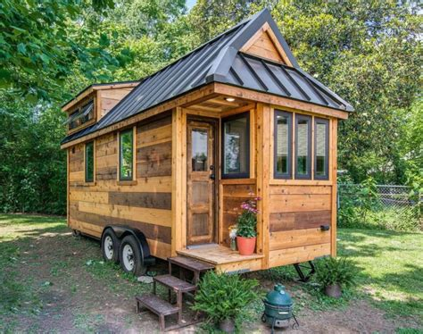 tiny house kits for sale a unique roof design with many this tiny farmhouse will make you want to downsize asap