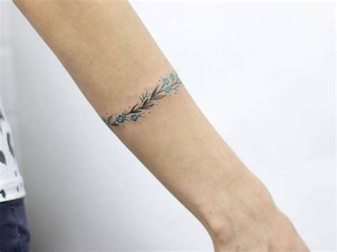 great small tattoos forget me not bracelet on the left forearm