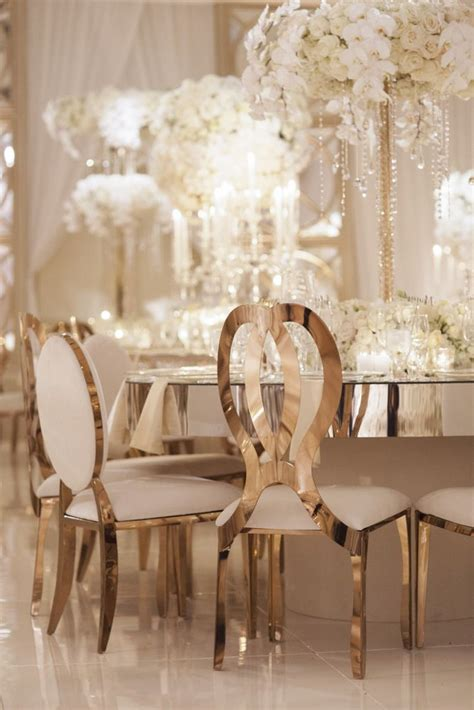 glamorous gold wedding chairs and mirror tables at four seasons beverly event design by