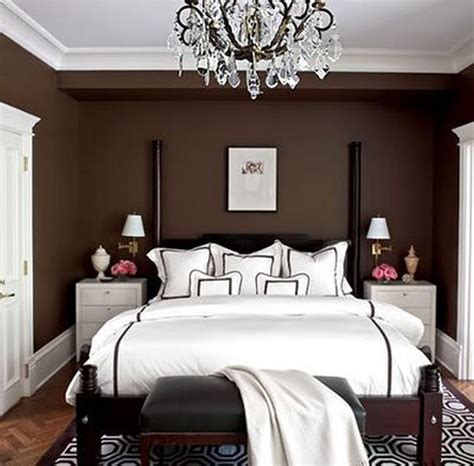 brown black bedroom brown wooden bed with white bed sheet plus black bench on