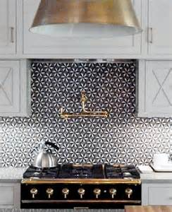 patterned backsplash tile back it up to black and white