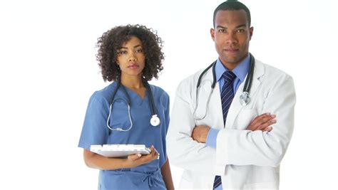 Stock Mainan Anak Doctor 3 In 1 Doctor Set Laris two american doctors standing looking at stock footage 2103995
