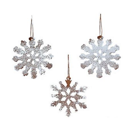 12 rustic metal snowflake ornaments in snow assorted