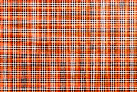 Plaid fabric red, orange, black, white, background   Stock