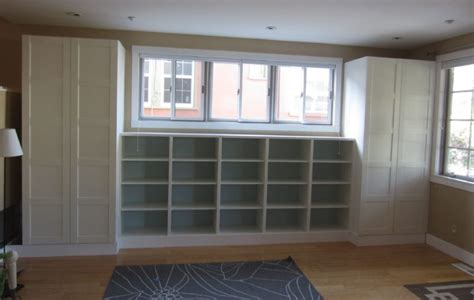 built in bookshelves with cabinet below furniture white stained wood built in book shelf sliding glass window among two
