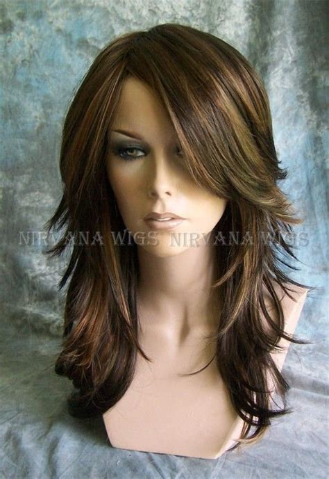 hair extensions that are already layered 3tone brown with auburn tones highlights long layered