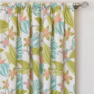 green flower curtains decorating living room with orange red and green