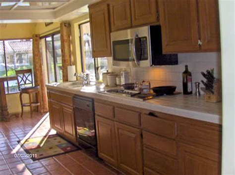 Painting Kitchen Laminate Cabinets diy painter uses new rustoleum cabinet transformations on
