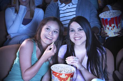 friends watching film   theater stock photo image