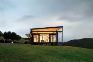 Hillside Home Designs truss style new zealand glass house with complex interior